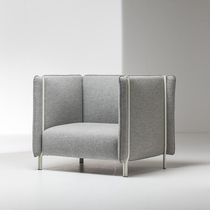 Contemporary armchair / tablet / fabric / leather