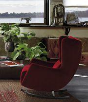 Contemporary armchair / metal / wing / rocker