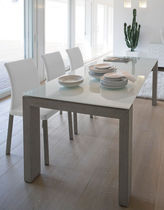 Contemporary dining table / glass / lacquered wood / rectangular