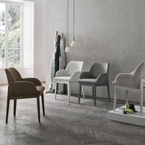 Contemporary chair / wooden / with armrests / upholstered