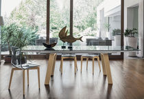 Contemporary dining table / tempered glass / painted metal / porcelain stoneware