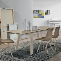 Contemporary dining table / tempered glass / metal / porcelain stoneware