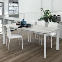 Contemporary dining table / MDF / tempered glass / painted aluminum