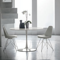 Contemporary dining table / lacquered MDF / tempered glass / painted metal