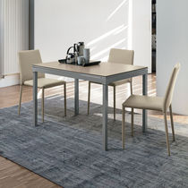 Contemporary dining table / porcelain stoneware / painted metal / MDF