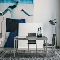 Contemporary dining table / tempered glass / painted metal / laminate