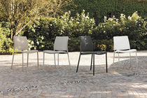 Contemporary chair / metal / upholstered / residential