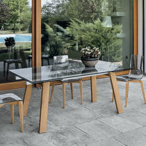 Contemporary dining table / painted metal / tempered glass / porcelain stoneware