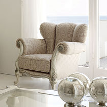Classic armchair / textile / wing