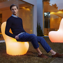 Original design fireside chair / illuminated / polyethylene / outdoor