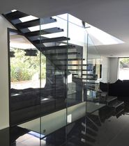 Quarter-turn staircase / oak steps / steel frame / glass frame