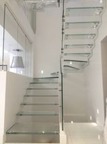 Half-turn staircase / glass steps / steel frame / metal frame