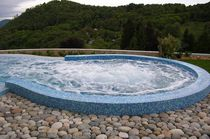 In-ground swimming pool / concrete / for wellness centers / wave