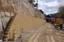 Reinforced concrete retaining wall / prefab / stone