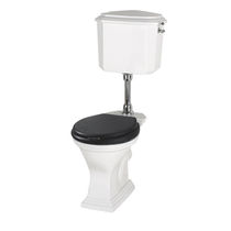 Free-standing toilet / monobloc / ceramic / with low tank