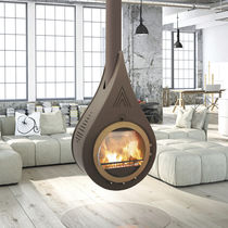 Wood-burning fireplace / contemporary / closed hearth / free-standing
