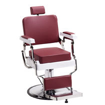 Chromed metal barber chair / swivel / with footrest / red