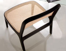 Contemporary fireside chair / fabric / beech / rattan