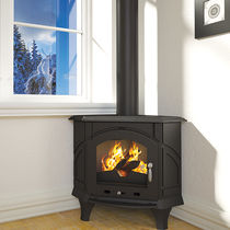 Wood heating stove / traditional / corner / cast iron
