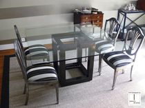 Contemporary dining table / metal / iron / lacquered metal