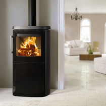 Wood heating stove / contemporary / metal / sandstone