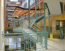 Half-turn staircase / concrete steps / metal frame / with risers