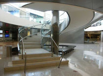 Circular staircase / lateral stringer / for commercial buildings / with risers