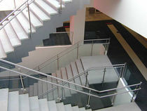 Half-turn staircase / concrete steps / lateral stringer / for commercial buildings