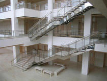 Straight staircase / lateral stringer / for commercial buildings / with risers