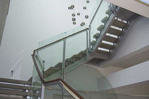 Half-turn staircase / metal frame / concrete steps / lateral stringer