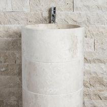 Free-standing washbasin / round / stone / contemporary