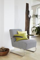 Contemporary armchair / with footrest / cantilever / solid wood
