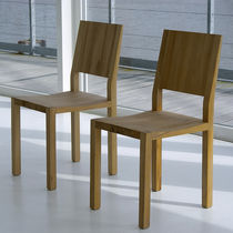 Contemporary chair / with armrests / solid wood