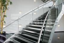 Helical staircase / stone steps / metal frame / without risers