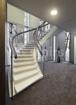 Helical staircase / concrete steps / metal frame / with risers