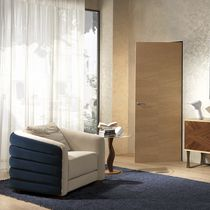 Contemporary armchair / fabric / leather / beige