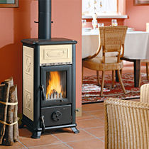 Wood heating stove / contemporary / cast iron / natural stone
