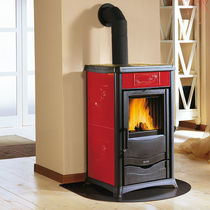 Wood heating stove / traditional / ceramic / cast iron