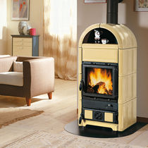 Wood heating stove / traditional / cast iron / ceramic