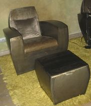Original design armchair / metal / with concealed casters / with armrests