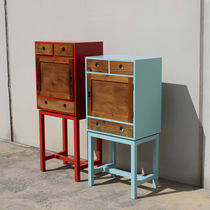 Chest of drawers with long legs / original design / matte lacquered wood / patinated wood