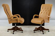 Traditional executive chair / leather / swivel / on casters