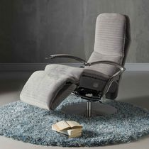 Contemporary armchair / fabric / leather / with footrest