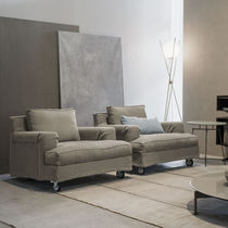 Contemporary armchair / fabric / on casters