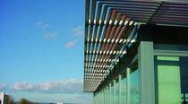 Aluminum solar shading / for facades / swiveling / horizontal