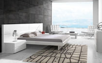Double bed / contemporary / integrated bedside table / lacquered wood
