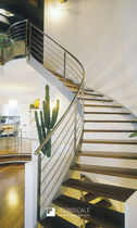 Circular staircase / wooden steps / metal frame / without risers