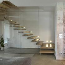 Half-turn staircase / wooden steps / metal frame / glass frame