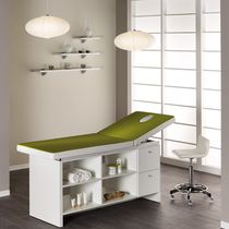 Fixed massage table / wooden / with storage compartment