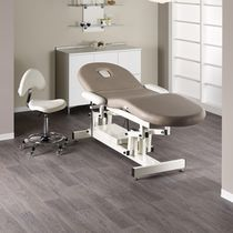 Electric massage table / height-adjustable